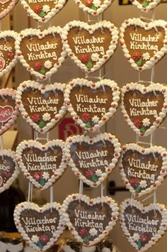 """Villacher Kirchtag / Patron Saint's Festival of Villach (Carinthia, Austria) takes place every year on the first weekend in August. It is preceded by a week of traditional folk music, dancing and eating... Here the traditional gingerbread hearts (""""Herz'ln"""") tokens of affection or plain souvenirs. Carinthia, Patron Saints, Folk Music, Austria, Gingerbread, Dancing, Hearts, Traditional, Places"""