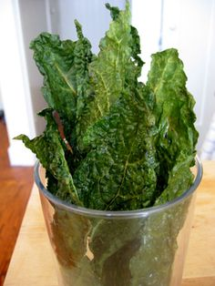 Tuscan Kale Chips  Ingredients    12 large Tuscan kale leaves, rinsed, dried, cut lengthwise in half, center ribs and stems removed  1 tablespoon olive oil  Salt  Pepper    Directions    Preheat oven to 250°F. Toss kale with oil in large bowl. Sprinkle with salt and pepper.  Arrange leaves in single layer on 2 large baking sheets. Bake until crisp, about 30 minutes for flat leaves and up to 33 minutes for wrinkled leaves.  Transfer leaves to rack to cool.  Makes approximately 24 chips.