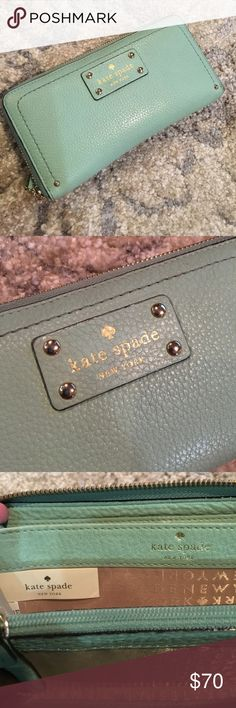 Authentic Kate Spade mint/light turquoise wallet I think it's more light turquoise than mint but either or it's a cute color! 16 cardholders, change section in the middle. In great condition with a couple of wear marks around the zipper (as seen in the picture). Make an offer! kate spade Bags Wallets