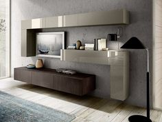 Sectional wall-mounted storage wall MOOD | Storage wall by Composit