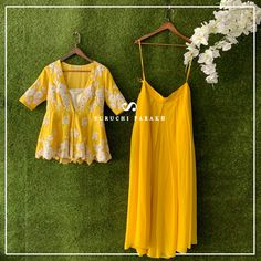 Love for yellow ❤️, upgrade your wardrobe with this beautiful lemon yellow peplum top which has beautiful intricate thread details paired with flared plazzo WE SHIP WORLDWIDE For further assistance please DM air Whatssap us on 9537165033 . Indian Fashion Dresses, Indian Gowns Dresses, Dress Indian Style, Indian Designer Outfits, Designer Dresses, Fashion Outfits, African Fashion, Indian Wedding Outfits, Pakistani Outfits