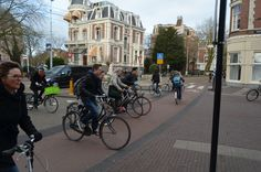Negotiating the street ballet, morning rush hour central Amsterdam