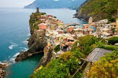 Cinque Terre, Rio, Italy - consisting of five villages separated by mountains full of olive groves & vineyards, and is named as a World Heritage Site by UNESCO and one of the most beautiful places in the World ~