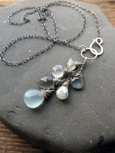 Icy gemstone and sterling silver mix necklace by Brenda McGowan. Aquamarine, sapphire, moonstone, silverite, quartz