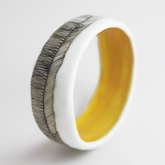Porcelain Bangle from Golden Ink; Line as surface decoration on clay