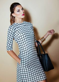 Cindy Dress with Square Pattern -$59.00 This straight cut dress has a raglan sleeve going across the bodice (curved stitch line above the chest), 3/4 sleeve length, and a knee length skirt (the model featured is 1.80 meters/ 5'9 feet)