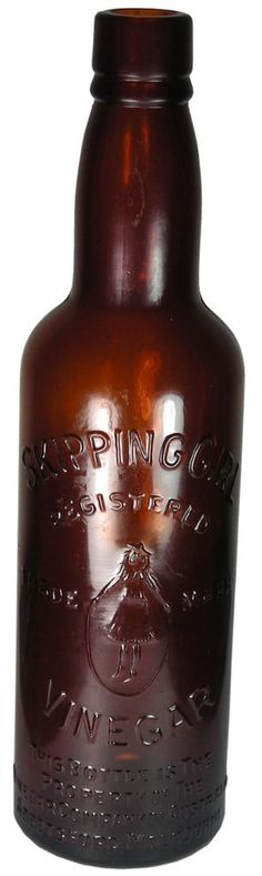 """Skipping Girl Vinegar. """"Little Audrey"""" trade mark. The property of the Vinegar Company of Australia, Abbotsford, Melbourne (Victoria). """"Modern"""" AGM Monogram to base with M354 mould number. Seam through lip. Straight sided variety. 13 oz. Amber. c1930s-1940s. ABCR Auctions 6, Lot 249. November 2011. Hammer Price: $20."""
