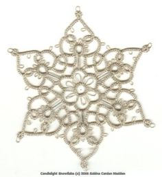 Paradise Treasures: Silver Candlelight Snowflake by Bina Madden -- Free pattern -- involves Loop Tatted Rings for the bead placement #tatting #technique #snowflake