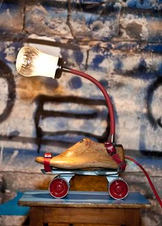 Vintage Roller Skates lamp by Studio ORYX. A fantastic upcycle lamp made out of old roller skates, a shoemaker's last and sugar dispensers.