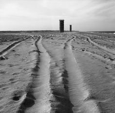 WWII towers on the beach in Delaware
