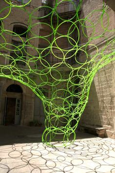 """Yes we can Architecture / 300 hula hoops were used in the installation, which is called Qui est """"in"""", Qui est """"out"""" after a song by Serge Gainsbourg."""