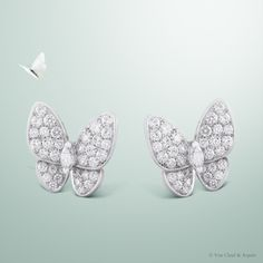 Van Cleef & Arpels Two Butterfly earclips set in white gold and diamonds #VCAspring