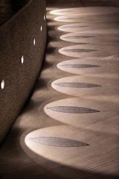 Landscaping Design Idea - Lights Highlight A Decorative Element On A Path