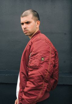 SchoolBoyCouture wears the red Alpha Industries x Dr Martens MA1 bomber