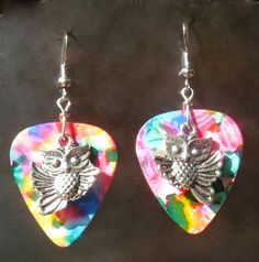 Hey, I found this really awesome Etsy listing at https://www.etsy.com/listing/151572054/flying-owl-earringswildlife-guitar-pick