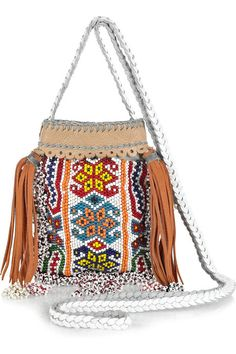 Paul & Joe Perlee handmade small beaded cross-body bag. Paul & Joe's handmade multicolored beaded bag with tan suede tassels will give chic summer looks a bohemian accent. Team it with cut-off shorts and stacked bracelets for luxe festival style. Multicolored handmade beaded cross-body bag with oversized tan suede tassels. Paul & Joe bag has a braided white leather shoulder strap, a nude leather trim with gray stitch detailing, is open at top and is fully lined in gray twill. Designer color…