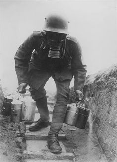 A German soldier brings food for his trench companions, World War I.