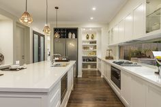 Light bright kitchen with slight cabinetry detailing