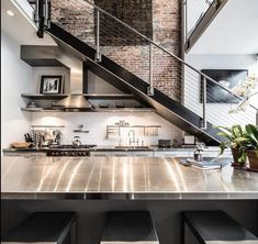 Stainless Steel Kitchen Countertops (Ultimate Guide) Loft apartment kitchen with stainless steel countertops Stainless Steel Countertops, Stainless Kitchen, Kitchen Countertops, Kitchen Cabinets, Loft Kitchen, Apartment Kitchen, Kitchen Hob, Kitchen Modern, Modern Farmhouse