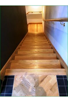 Trinity Restaurant Staircase - Oak staircase with a quarter landing leading to the first floor,  32mm treads with flush nosing and anti-slip grooves have been chosen for these stairs along with an oak wall handrail.
