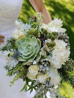 Eco-friendly bouquet idea: This lush bouquet in grey, white and pale blue includes a cutting that can be rooted and planted after the wedding is over