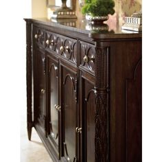Celebrated Low country rice post carving and astragal moulding detail are highlights of the East Battery Buffet in Classic Mahogany. The design features four doors, three drawers, three adjustable shelves and one blue silver liner in the center drawer. | Stanley Furniture