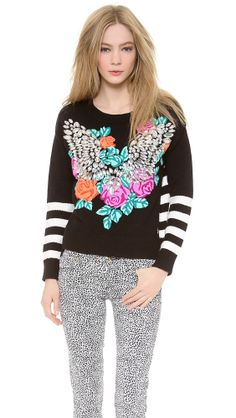 Crystal Wings Pullover, Juicy Couture only at http://tllg.net/WnzO!  Price: $160.80  Faux jewel accents and vibrant embroidery turn this Juicy Couture sweater into a statement piece. Asymmetrical hem. Long sleeves.  Fabric: Soft knit. Shell: 61% cotton/39% acrylic. Trim: 81% cotton/19% cashmere. Wash cold. Imported, China.  MEASUREMENTS Length: 21.5in / 54.5cm, from shoulder   www.fsession.com