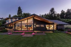 Modern dormer with a low sweeping roof that opens up to an amazing view of Portland