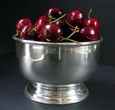 Cherries in a silver bowl