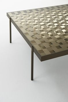 FRAGMENT high and low tables | design Nendo | GLAS ITALIA 2017 collection |  high and low tables with a special checked decoration on double-sided mirror or in tempered bronze glass. Two perpendicularly checked crystals are applied to a double-sided silver shiny polished aluminum frame separated by a gap of a few centimetres. These objects create a game of mirrored reflections, coverings and transparencies that deceive the observer, dissimulating and confusing the objects reflected from the…