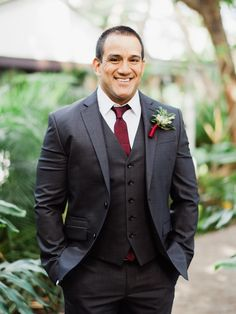 classic red and dark grey groom attire