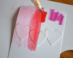 Journalling card...punch out hearts adhere, watercolour paint across hearts