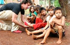 Blake Mycoskie; Buy a pair of Toms shoes and a pair is donated to a child in need.