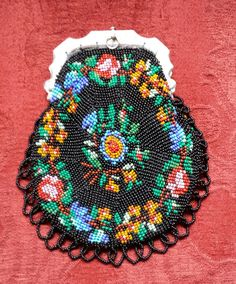 knitted  with  antique beads on 100% silk tread.  Silver frame 1868 knitted  by  Tineke Nieuwenhuijse