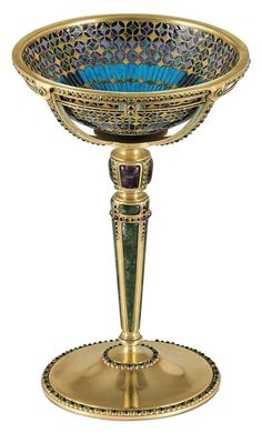 AN IMPORTANT GOLD, PLIQUE-A-JOUR ENAMEL, AND GEM-SET CUP DESIGNED BY LOUIS COMFORT TIFFANY - MARK OF TIFFANY & CO., NEW YORK, 1916.