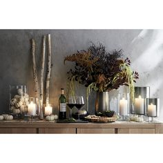 Shop London Glass Hurricane Candle Holders. A Crate and Barrel classic, these handcrafted glass hurricanes, look as beautiful reflecting candlelight as they do filled with twinkling garlands or terrarium plantings.