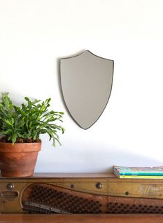 Shield Mirror Crest Mirror Handmade Mirror Wall Mirror...  This would be awesome in the kids' rooms with the armor of God scripture (or stand for truth  righteousness) done in vinyl...
