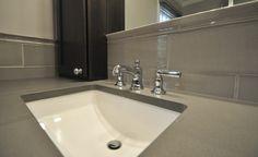 Kohler Chrome Fixtures, Under Mount Sink, Linen Ceramic Tile.