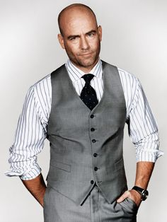 Stripes with solid tie and gray vest.  I've seen this with jeans as well.  Nice clean look.