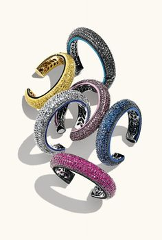 """M.C.L. by Matthew Campbell Laurenza   Sapphire, ruby or moonstone pavé small """"Stardust Curve"""" bangles."""