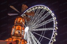 A ferris wheel at an entertainment park. Lit up well at night, you can almost hear kids' screams and whoops of delight Party Entertainment, Royalty Free Photos, Ferris Wheel, Light Up, Small Caps, Fair Grounds, Entertaining, Stock Photos, Park