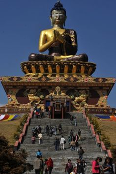 Visitors at the 40-metre (130ft) tall Lord Buddha statue during the Dzung ceremony to unveil the Buddha park at Rabong in South Sikkim, India. The park, called Tathagatatsal, covers an area of 9.3 hectares (23 acres).