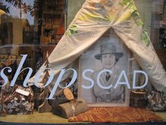 Shop window celebrating 100th anniv Girl Scouts #Savannah. Drawing of Juliette Gordon Low by #SCAD grad Kellie Walker.