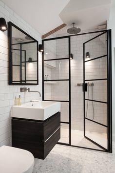 floor to ceiling shower door black trim framed mirror tiled wall marble floor white sink dark vanity rain shower of Fabulous Ideas of Guest Master Bathroom Remodel for Everyone's Satisfaction