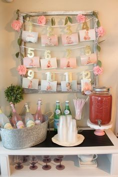 Display your babies monthly photos from the first year of their life at their first birthday party.  I had a floral and pink themed party for my little girl and I displayed the photos above the drink bar.  It made getting drink of lemonade even sweeter!                                                                                                                                                                                 More