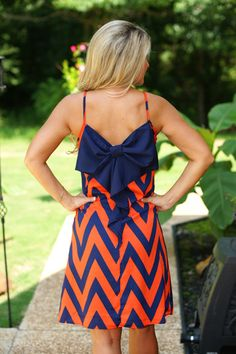 This site is great! How cute is this dress?? Chevron Cheer Bow Dress - Orange/Navy