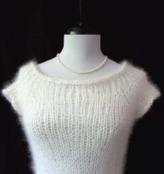 If you're in the market for lightweight free knitting patterns for sweaters, then have I got a treat for you.  This Airy Top Down Raglan Sweater will make the perfect addition to your summer or spring wardrobe.  What makes this professional looking sweater even more intriguing is that there is no seaming required.  Pair it with a colorful tank top and jeans and you're ready to go!