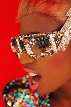 Bling was the most fashionable accessories during this time. From earrings to sunglasses to even studs stuck to their teeth. The more bling you wore the cooler one would look.