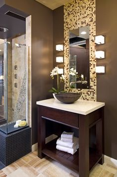 Glass tile displayed behind a mirror at Ispiri's Inspired Design Kitchen & Bath Showroom