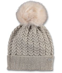Luxury meets comfort and super cute style with this Sundae oatmeal pom beanie from Empyre. A touchably soft and oversized fur pom paired with a heathered oatmeal tight knit folded beanie creates the perfect cold weather accessory.